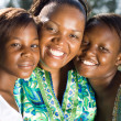 Stock Photo: Happy african mother and daughters closeup portrait