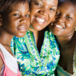 Happy african american mother and daughters closeup portrait — Stock Photo