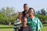 Happy african family portrait outdoors — Stock Photo