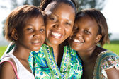 Happy african mother and daughters closeup portrait — Stock Photo