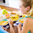 Young couple having healthy breakfast together — Stock Photo #12442463