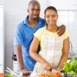 African american couple cooking in kitchen — Stock Photo #12442619