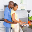 African american couple cooking in kitchen — Stock Photo #12442620