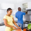African american couple cooking in kitchen — Stock Photo #12442623