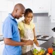 African american couple cooking in kitchen — Stock Photo #12442625