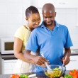 African american couple cooking in kitchen — Stock Photo