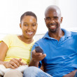 Young happy african american couple watching TV — Stock Photo #12442638