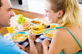 Young couple having healthy breakfast together — Stock Photo