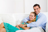 Young happy couple relaxing at home — Stock Photo
