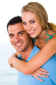 Happy young couple piggyback — Stock Photo