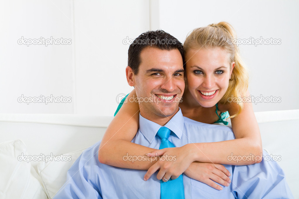 Young lovely couple sitting on sofa — Stock Photo #12442478