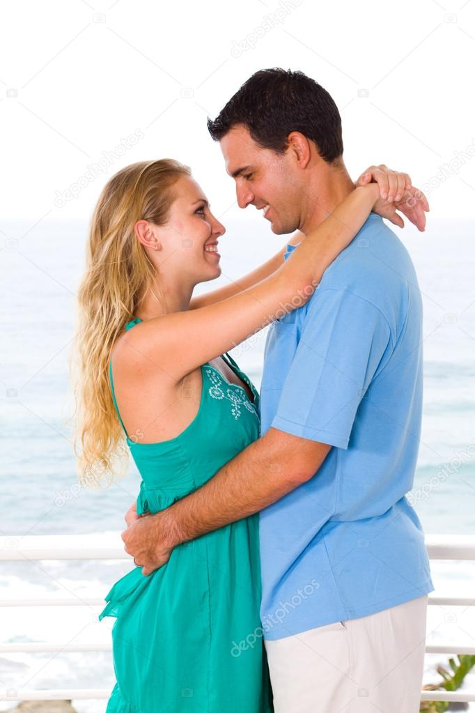 Lovely young couple hugging, background is beautiful sea view — Stock Photo #12442489