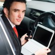 Stock Photo: Businessman inside a car