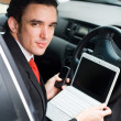 Businessman inside a car — Stock Photo