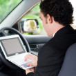 Stock Photo: Business man working inside a car