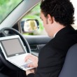 Business man working inside a car — Stock Photo
