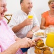 Royalty-Free Stock Photo: Happy senior friends having breakfast