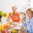 Happy friends having breakfast — Stock Photo #12485563