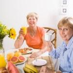 Happy friends having breakfast — Stock Photo