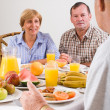 Happy friends having breakfast — Stock Photo #12485570