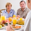 Happy friends having breakfast — Stock Photo