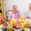Stock Photo: Senior friends having breakfast together