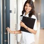 Businesswoman opening office door — Stock Photo