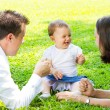 Happy young family outdoors — Foto Stock