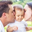 Royalty-Free Stock Photo: Parents kissing baby girl