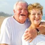 Laughing senior couple hugging — Stock Photo