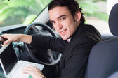 Young businessman working on the move — Stock Photo