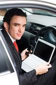 Businessman inside a car — Stock Photo