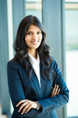 Female white collar worker in office — Stock Photo