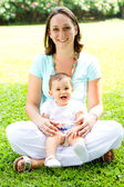 Happy mother and baby outdoors — Stock Photo