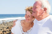 Happy senior citizen couple hugging — Stock Photo