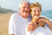 Laughing senior couple hugging — Stock Photo