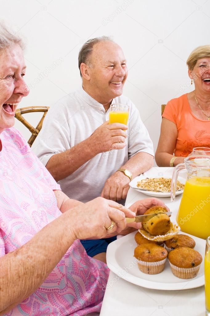 Happy senior friends having breakfast together — Stock Photo #12485562