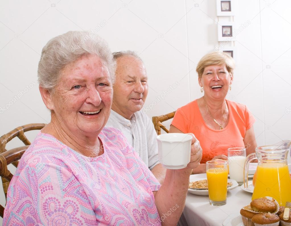 Happy senior friends having breakfast together — Stock Photo #12485569
