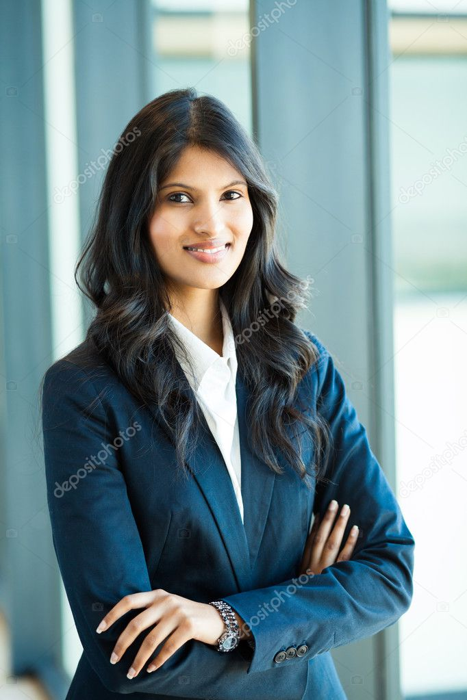 Attractive female white collar worker in office  Stock Photo #12485610