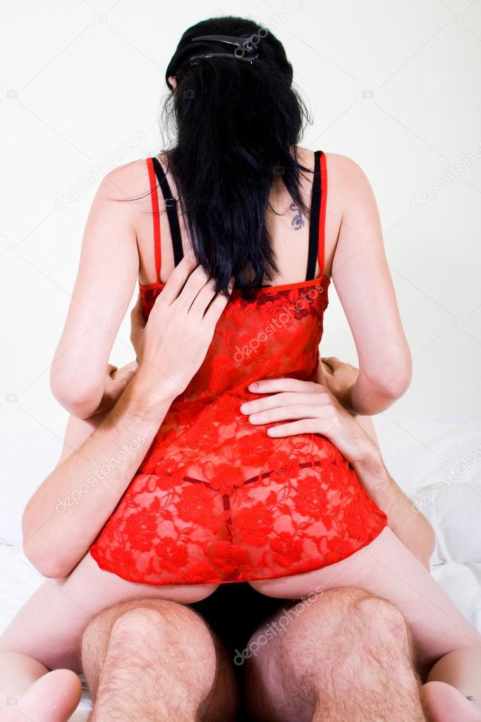 Young woman in lingerie sitting on man's lap — Foto Stock #12485739