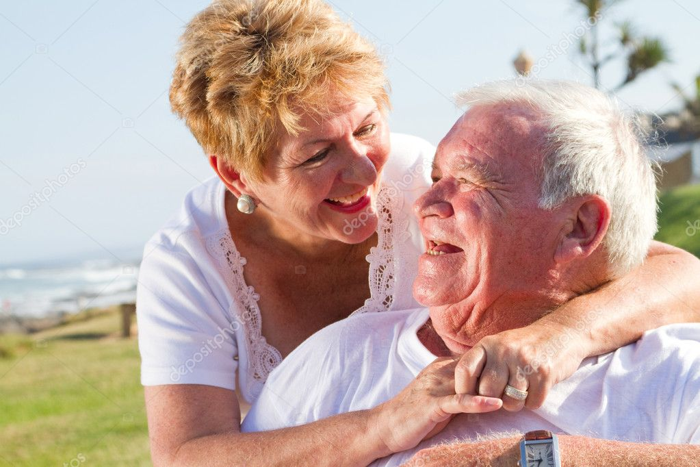 Happy laughing senior couple — Stock Photo #12485937
