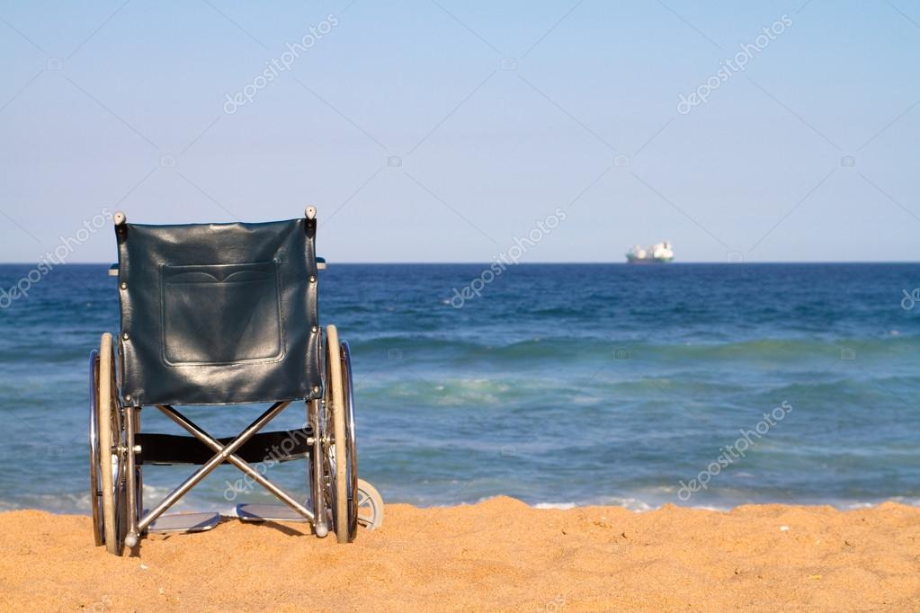 Wheelchair on beach — Stock Photo #12485947