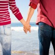 Couple hand in hand on the beach — Stock Photo #12527830