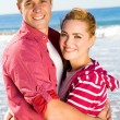 Young couple hugging on beach — Stock Photo #12527834