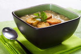 Noodle soup with croutons and coriander — Stock Photo