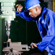 African american drilling machine operator in workshop — Stock Photo