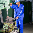 African american machinist operating drilling machine — Stock Photo