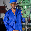 Royalty-Free Stock Photo: Male african blue collar worker in workshop