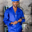 Young african factory working in workshop with hammer — Stock Photo #14754079