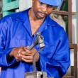 African american blue collar worker in workshop — Stock Photo